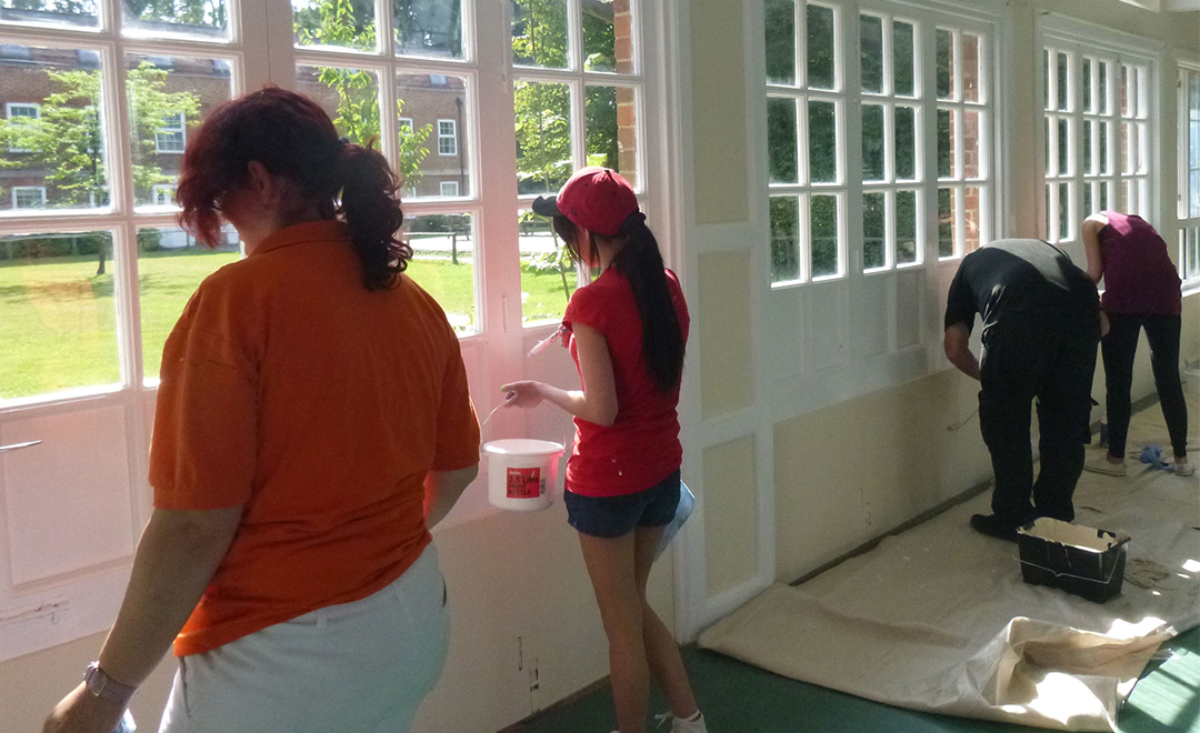 Axis volunteers painting for wide horizons