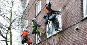 Workmen installation external wall insulation
