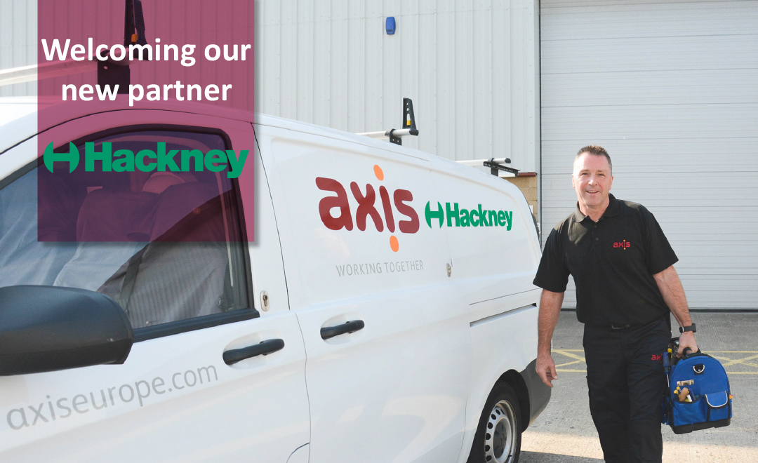 Axis person stood beside van with Hackney client logo on