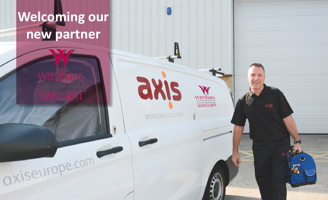 Axis person stood beside dual branded van announcing new contract win with wrexham council