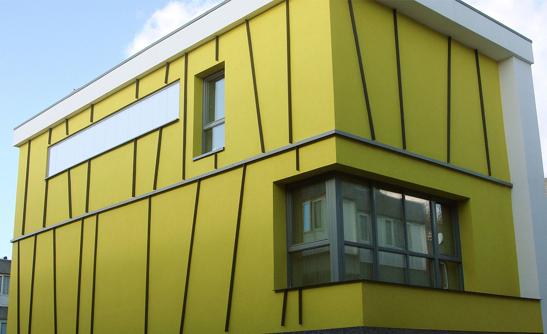 Yellow outer wall of an Energy efficient retrofit