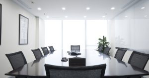 Spacious board room design with in ceiling lighting