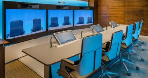 High tech boardroom showing interactive smart boards and interview cameras.