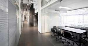 Clear meeting panels showing an industrial inspired workspace
