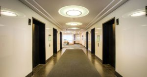 Lift lobby refit with black slate flooring and carpet title inlay