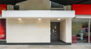Semley House portland stone entrance with gold leaf engraved building name