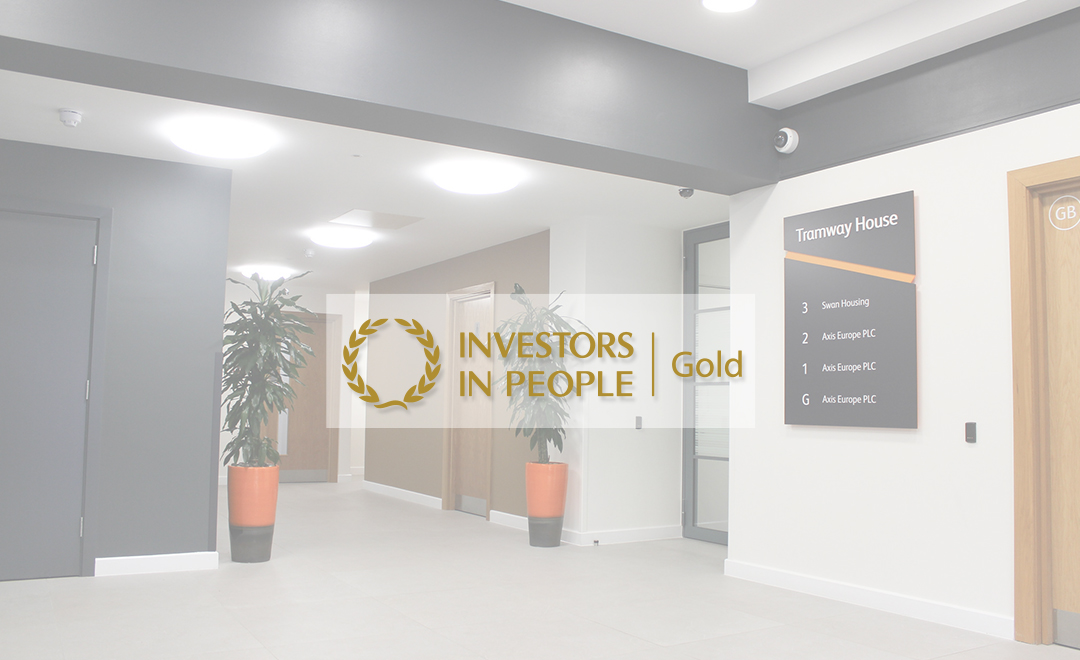 Aixs office with the investors in people gold award logo