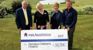 Representatives from the Axis Foundation presented a cheque for £54,000 to representatives of Demelza Hospice Care for Children