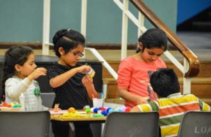 Children participating in craft events.