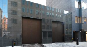 Granite wall cladding and aluminium bifolding doors