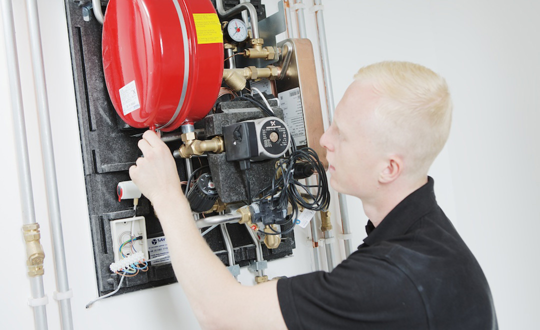 Axis gas operative working on a boiler after Axis achieves 100% compliance for gas servicing contracts