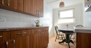 New kitchen installation showing wood laminate kitchen cupboards