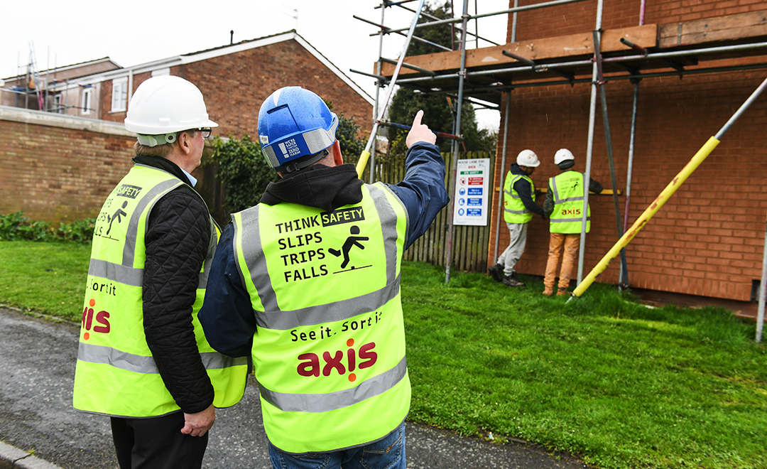 Axis site operative discusses works with manager
