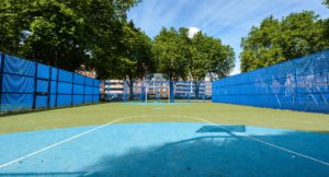 Basketball court with astro turf grounds.