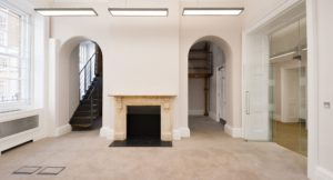 Newly refurbished office with original fire place and historic sorting room at the rear.