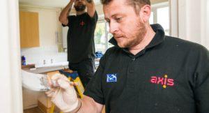 Axis workers wearing dual branded Swan work clothing