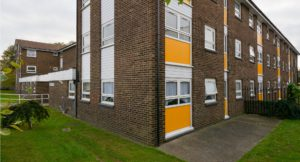 Newly refurbished exterior brickwork with yellow panelling