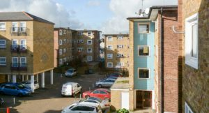 Flats in a Gravesham Estate with an Axis van parked in the middle.