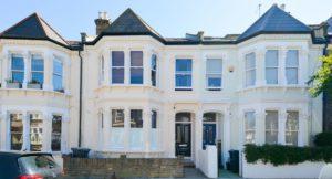 Cream coloured exterior L & Q terraced houses, Leander Road
