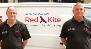 Image showing two Red Kite workmen stood next to a dual branded van
