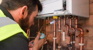 Walsall Housing Compliance Axis operative with blowtorch and copper piping