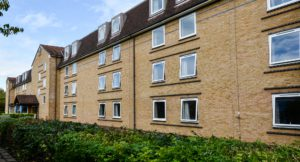 Exterior shot of Brunel University Mill Hall student accommodation with planting