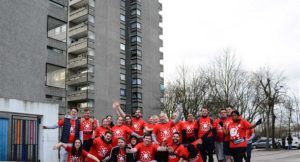 Axis fundraisers stood outside Thamesmead tower block