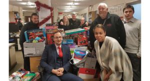 Axis employees surrounded by donated toys in Kingston office