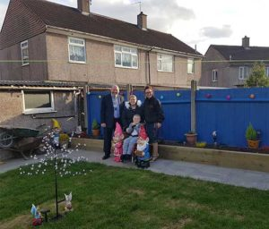 Young boy Edan Lane smiling in new garden transformed by Axis and partners