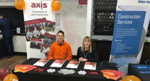 Two employees representing Axis at an event during National Apprenticeship Week.