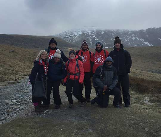 Axis fundraisers participating in Snowdon climb to raise money for Demelza.