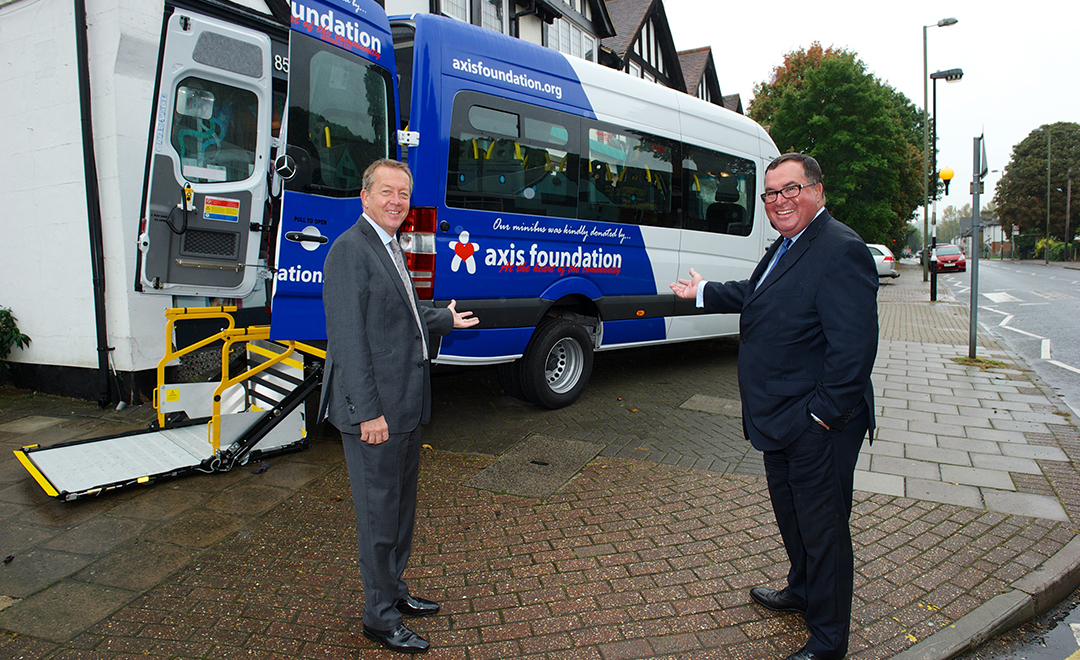 Axis foundation trustees donating a minibus to a small local and impactful charity