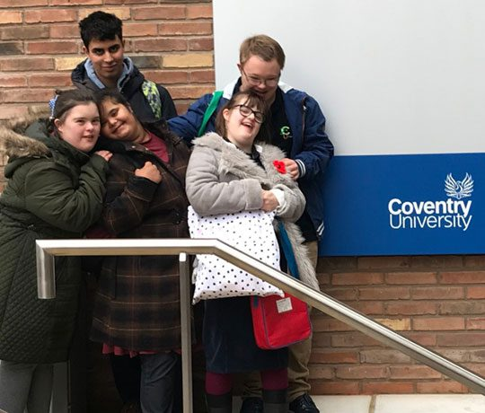 Four young vulnerable people outside Coventry University