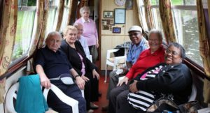 Group of people on a boat inside cabin