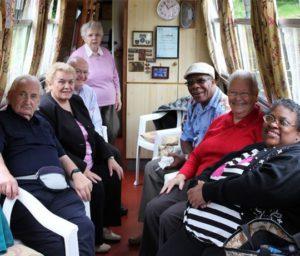 Inside a cabin on a boat, group shot