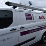 White van with purple logo Warwick District Council and orange axis logo