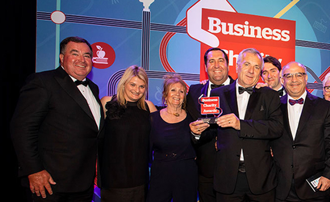 The Axis foundation trustees on stage accepting a charity business award