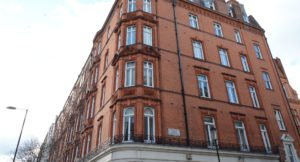 Sloane Street Herbert Mansions residential apartment block with red brick exterior above shops