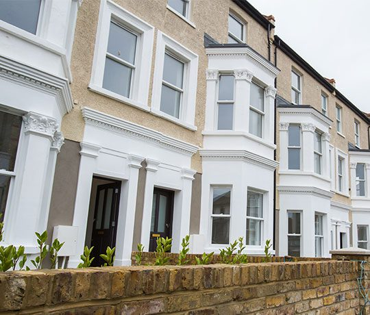 Exterior of Victorian terraced houses with bay windows and brick walls to front garden thumbnail