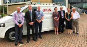 Axis employees on the Melton BC contract stood infront of Axis branded van.