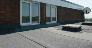 Roof top shot with windows and asphalt roof sheets