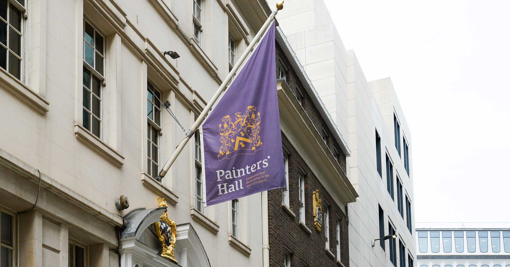 Purple flag at entrance door to Painter-Stainers