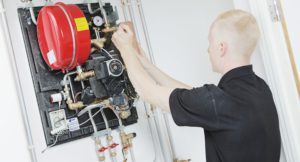 Axis worker servicing a gas boiler.