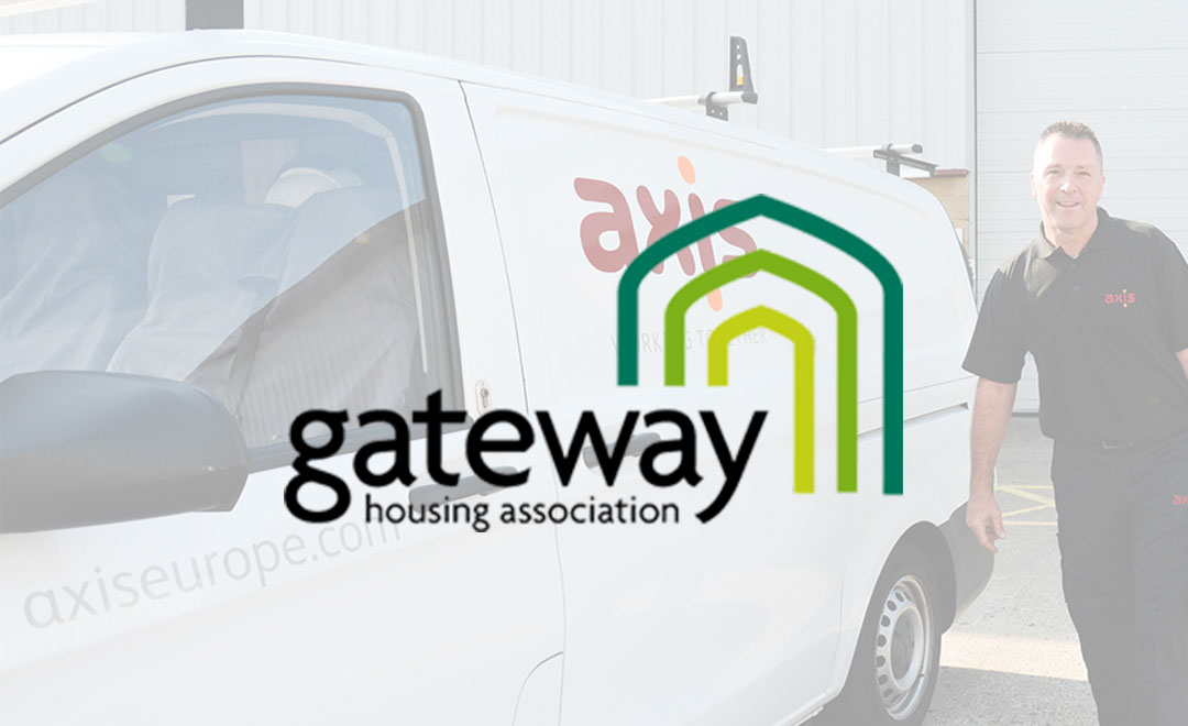 Axis person stands beside a van to announce new contract win with Gateway housing