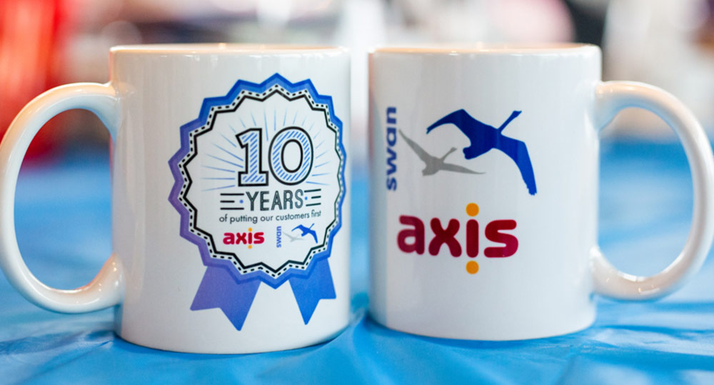 Two mugs with Axis and Swan logos on