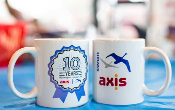 Axis and swan dual branded cups to celebrate a long standing client relationship