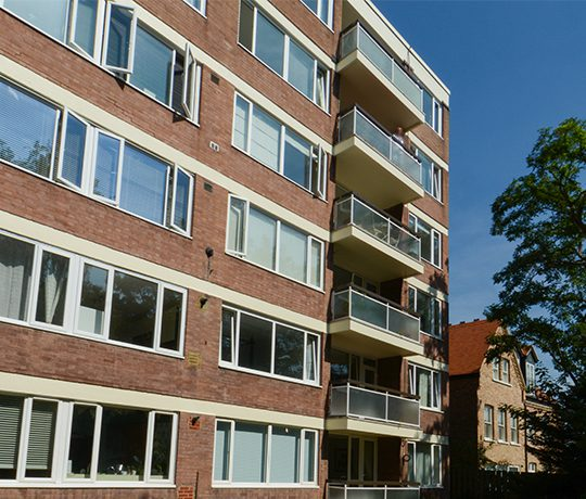 Exterior of Altior Court block of flats with tree