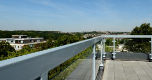 Rooftop focus on powder coated balcony railing in grey