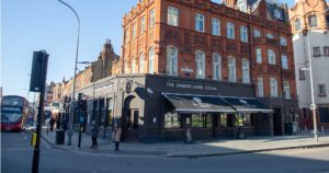 Exterior shot Sindercombe Social, street scene with pavement and shoppers