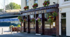 The facade of the Gipsy moth with the cutty sark in the background